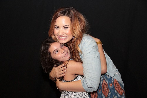 Demi Lovato at a meet and greet with a young fan
