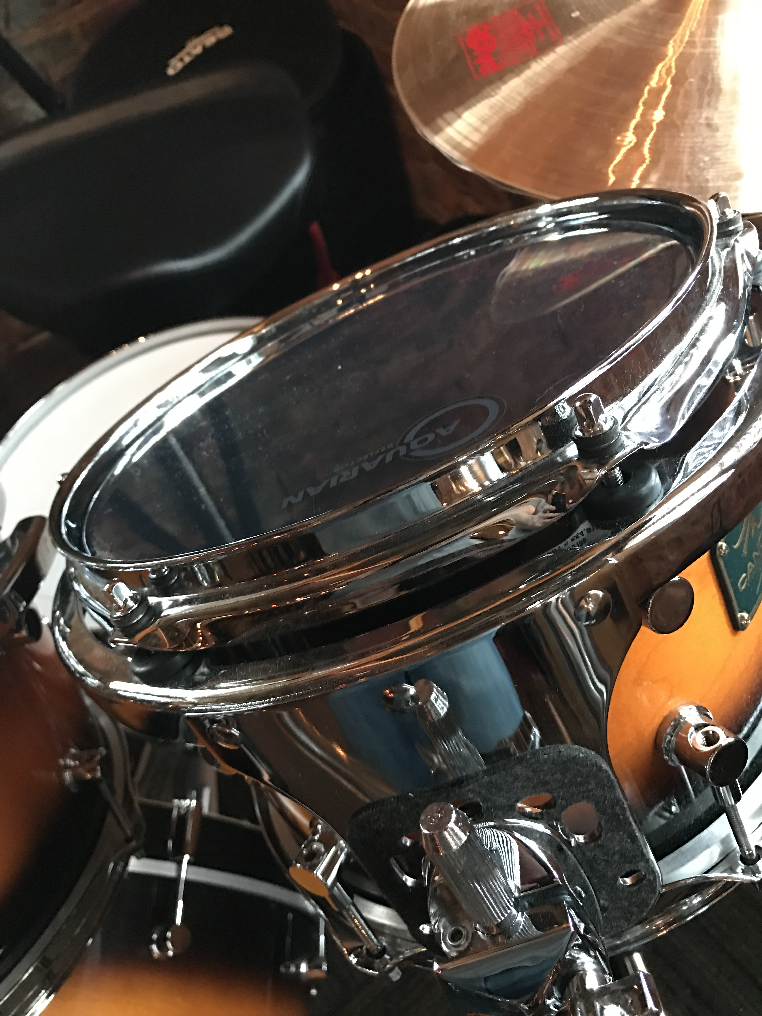 A Reflector head mounted on a Canopus drum kit